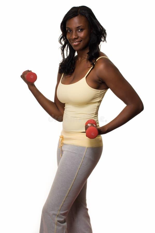 Mujer que hace ejercicios de brazo fotos de archivo