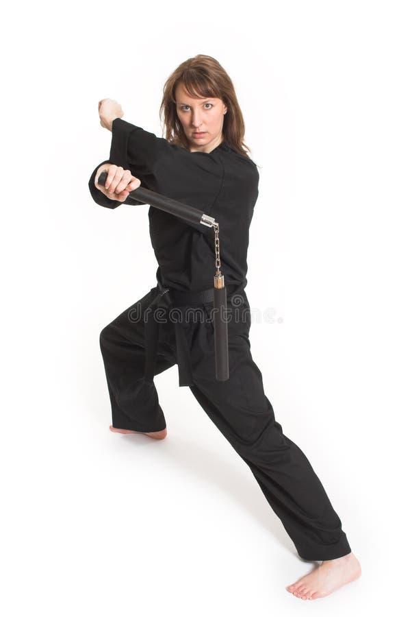 Mujer que hace karate fotos de archivo