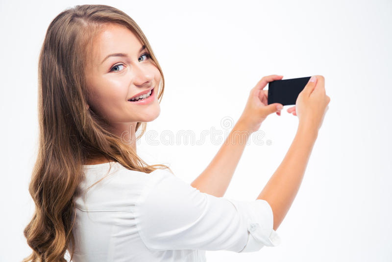 Mujer que hace la foto en smarptone imagen de archivo