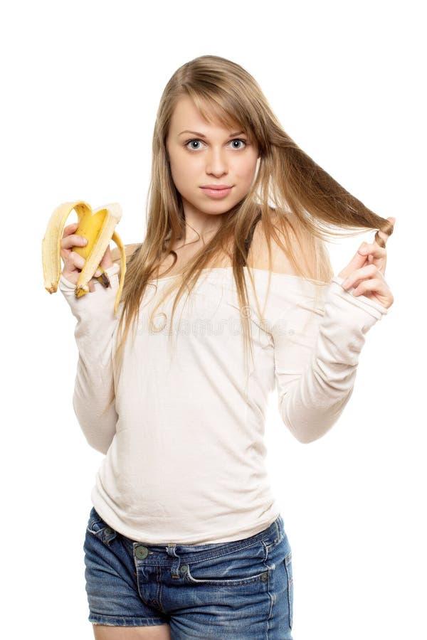 Mujer que juega con el pelo imagenes de archivo