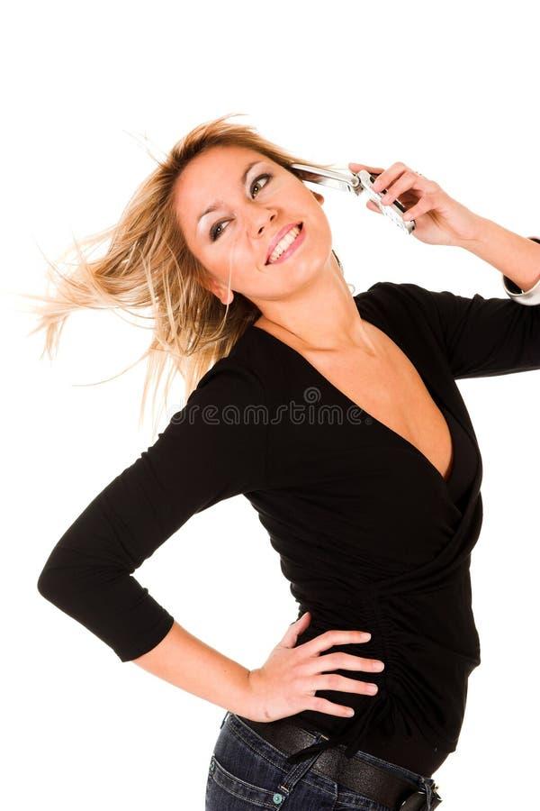Mujer que llama por el teléfono móvil fotografía de archivo