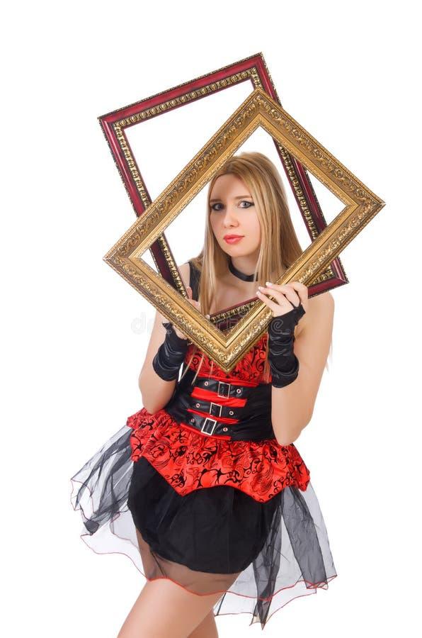 Mujer que lleva a cabo el marco fotos de archivo
