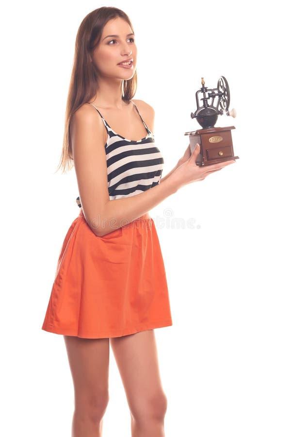 Mujer que lleva a cabo las manos en una amoladora mecánica imagen de archivo libre de regalías