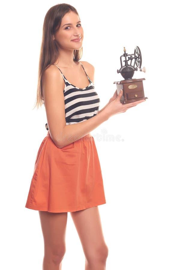 Mujer que lleva a cabo las manos en una amoladora mecánica foto de archivo libre de regalías