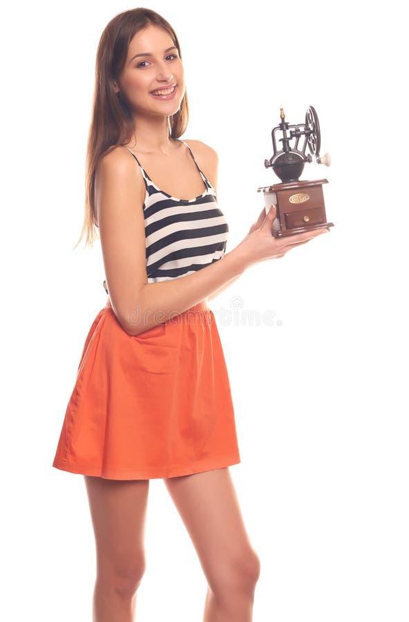 Mujer que lleva a cabo las manos en una amoladora mecánica fotos de archivo libres de regalías