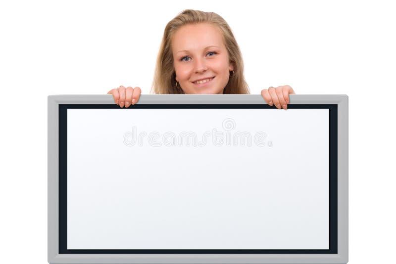 Mujer que lleva a cabo a una tarjeta vacía foto de archivo