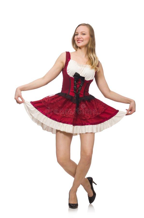 Mujer que lleva el vestido rojo en concepto de la moda aislado foto de archivo