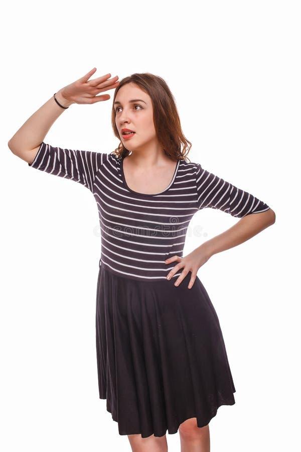Mujer que mira en la mano de la distancia aislada encendido fotografía de archivo libre de regalías