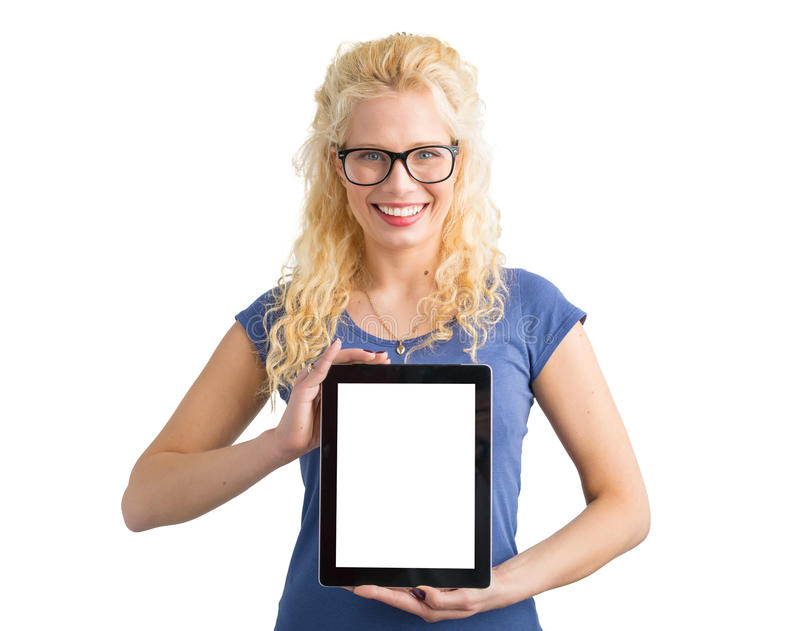 Mujer que muestra la tableta de la pantalla en blanco fotos de archivo