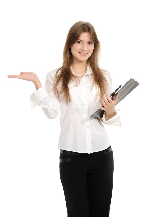 Mujer que presenta un producto imagen de archivo libre de regalías