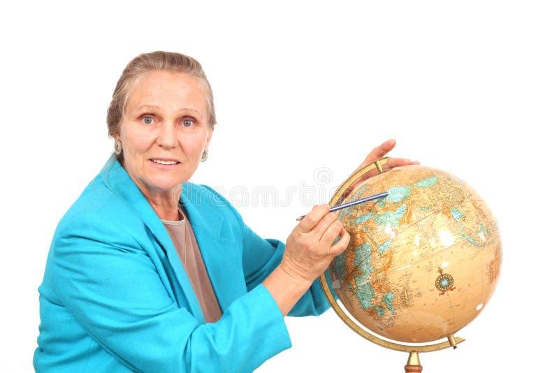 Mujer que señala al globo imágenes de archivo libres de regalías