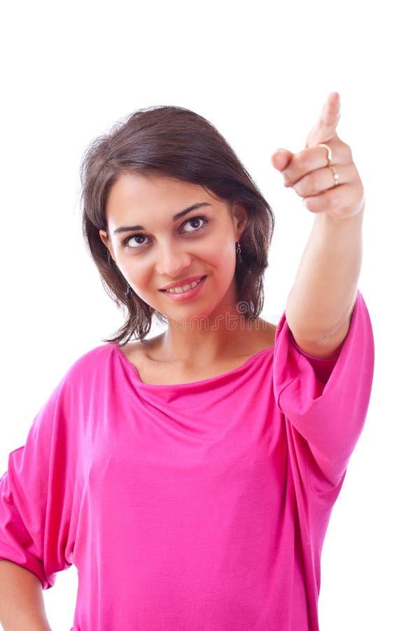 Mujer que señala a la cara contra fotografía de archivo