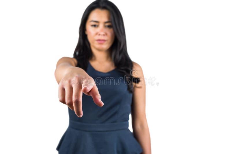 Mujer que señala su finger adelante fotos de archivo libres de regalías