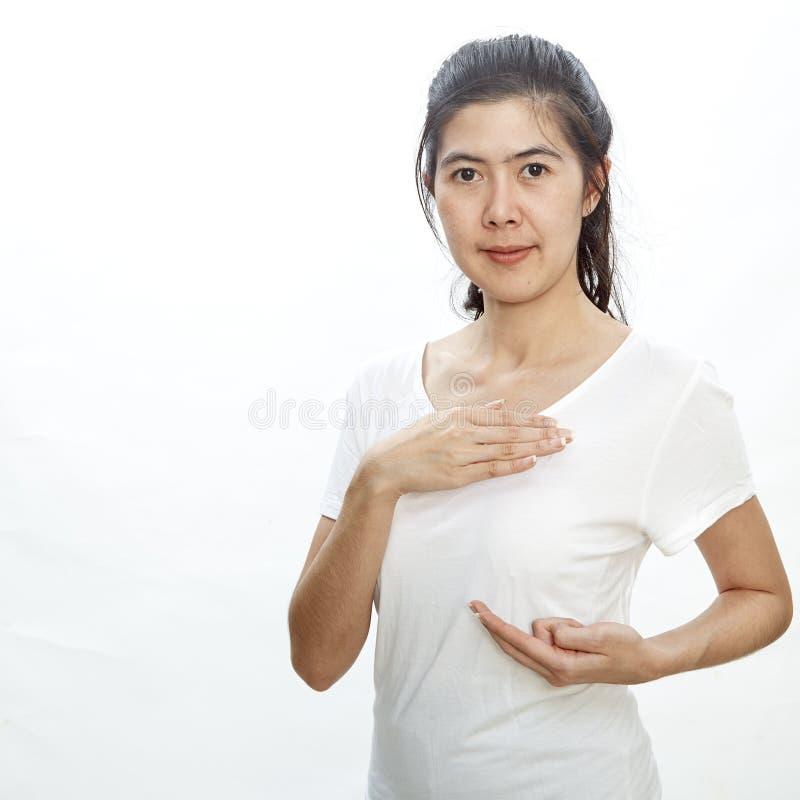 Mujer que se examina para el cáncer de pecho imágenes de archivo libres de regalías