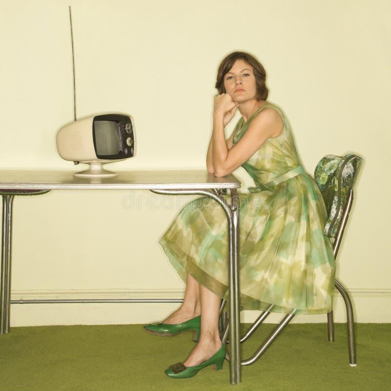 Mujer que se sienta en el vector. foto de archivo