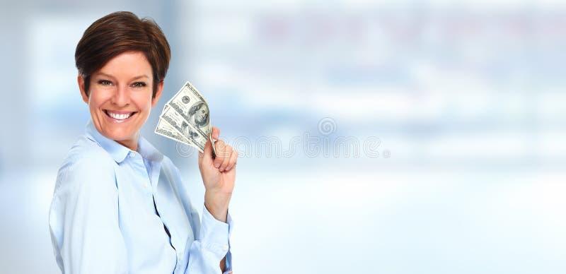 Mujer que sostiene el dinero imagen de archivo