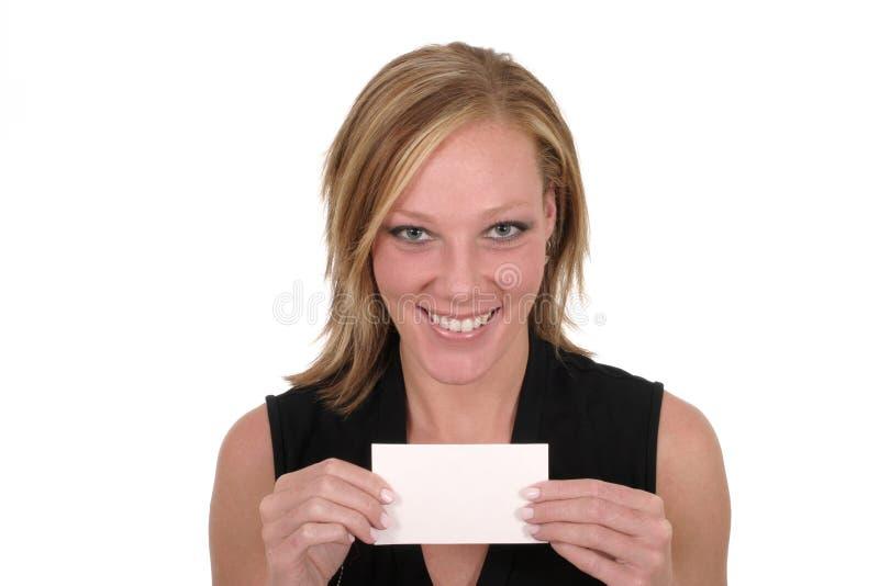 Mujer que sostiene la tarjeta en blanco 6 imagenes de archivo