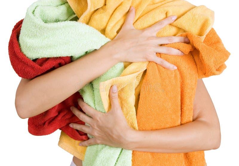 Mujer que sostiene mucho lavadero colorido en sus manos, o aislado fotos de archivo libres de regalías