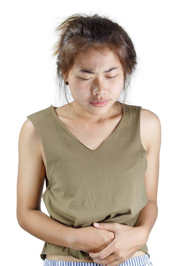 Mujer que tiene dolor de estómago aislado en blanco fotografía de archivo libre de regalías