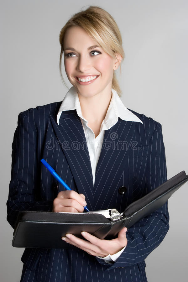 Mujer que toma notas imagenes de archivo
