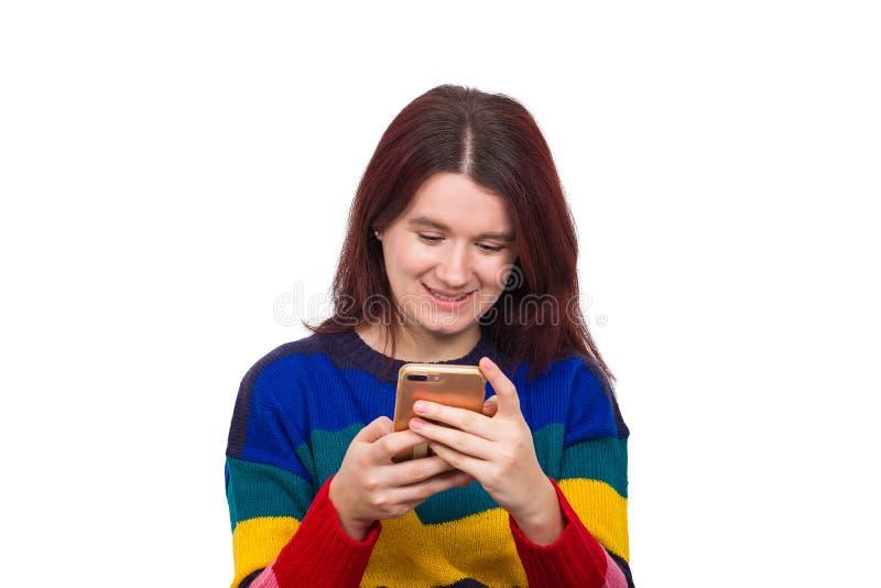 Mujer que usa el teléfono fotos de archivo