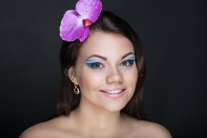 Mujer rosada brillante de la orquídea fotografía de archivo libre de regalías