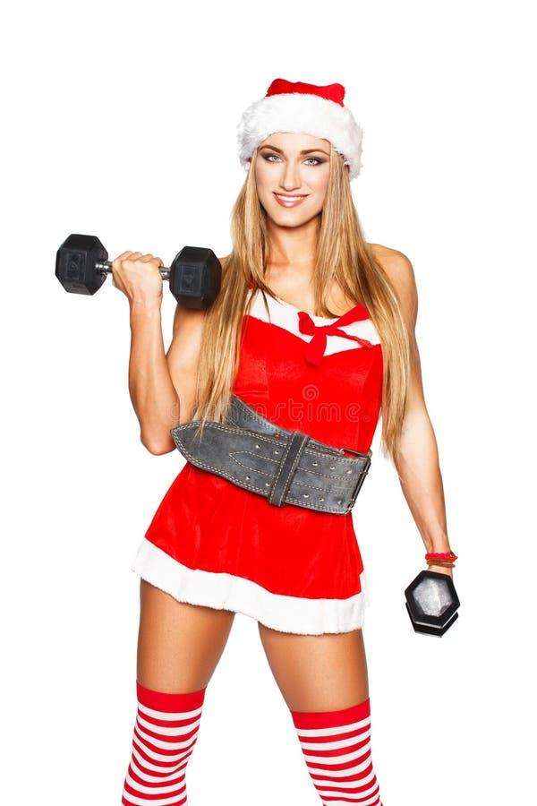 Mujer rubia atractiva de la aptitud con pesa de gimnasia fotografía de archivo