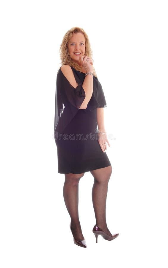 Mujer rubia en alineada negra fotografía de archivo