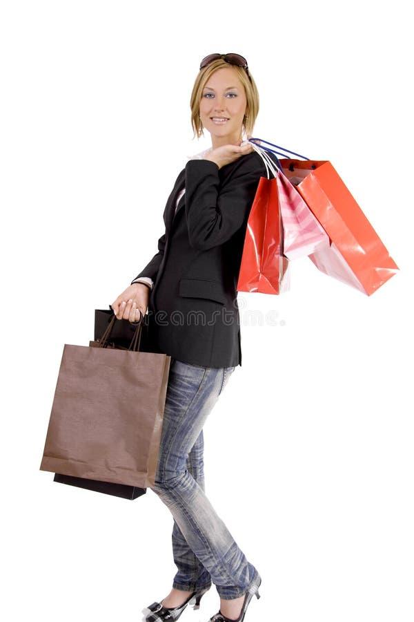 Mujer rubia en juerga de compras fotos de archivo