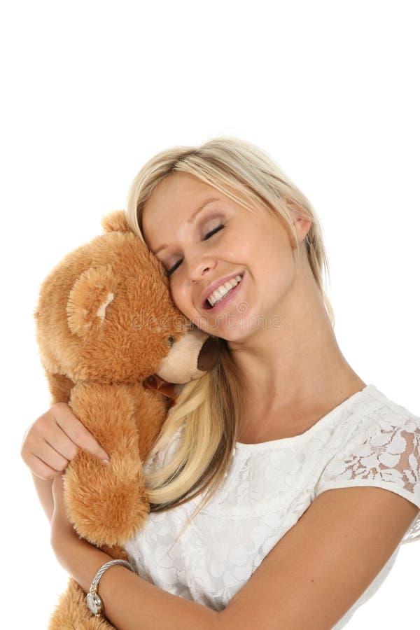 Mujer rubia encantadora con el animal del juguete imagen de archivo libre de regalías