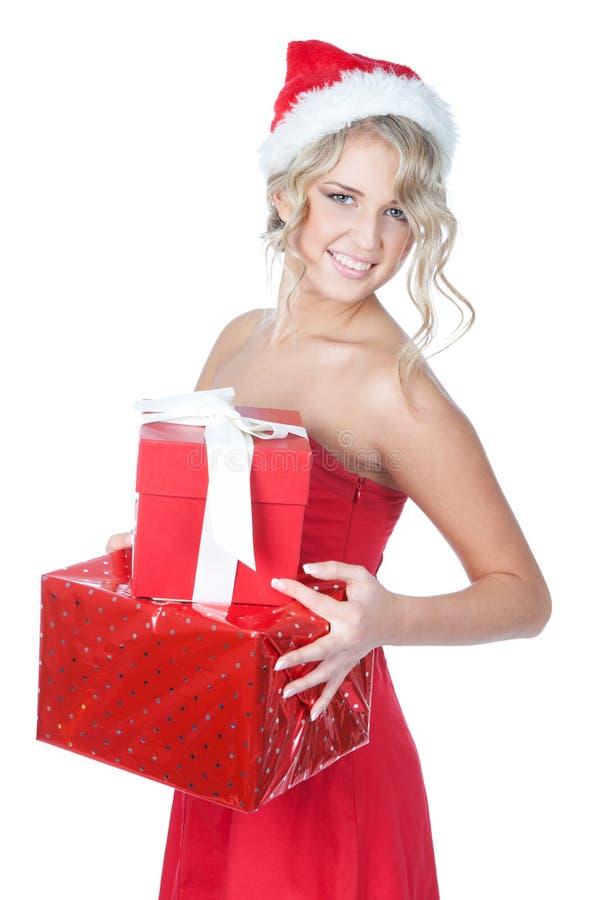Mujer rubia hermosa de la Navidad con los regalos imagen de archivo