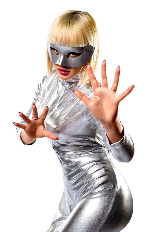 Mujer rubia joven en máscara imagen de archivo libre de regalías