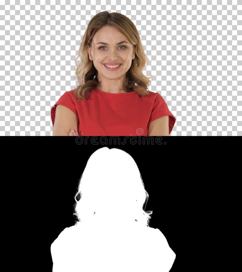 Mujer rubia joven que es cambio serio y después sonriente en el humor, emociones, Alpha Channel foto de archivo