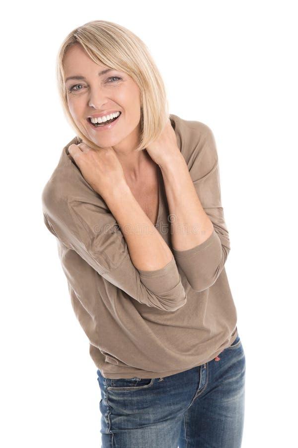 Mujer rubia madura aislada de celebración y que anima con primero foto de archivo libre de regalías