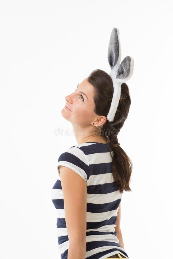 Mujer soñadora con los oídos de conejo fotografía de archivo libre de regalías