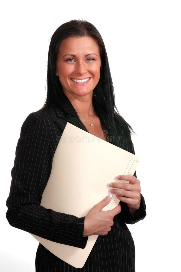 Mujer sonriente con las carpetas fotos de archivo