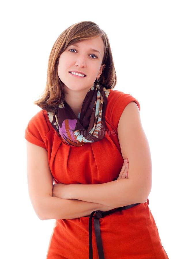 Mujer sonriente en alineada anaranjada ocasional fotos de archivo libres de regalías