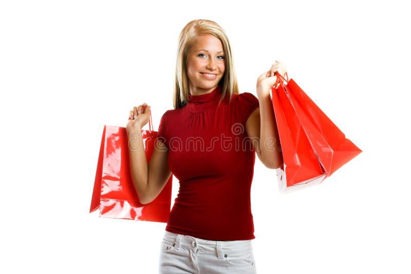 Mujer sonriente en las compras foto de archivo