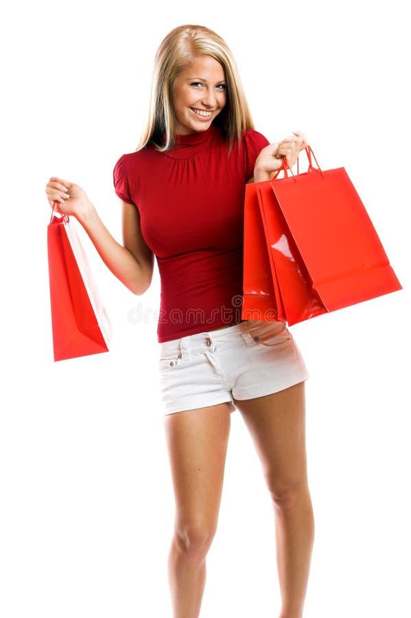 Mujer sonriente en las compras fotografía de archivo