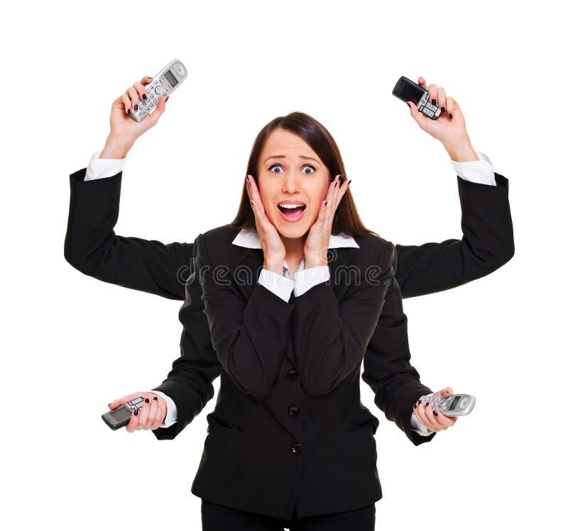 Mujer tensionada con los teléfonos imágenes de archivo libres de regalías