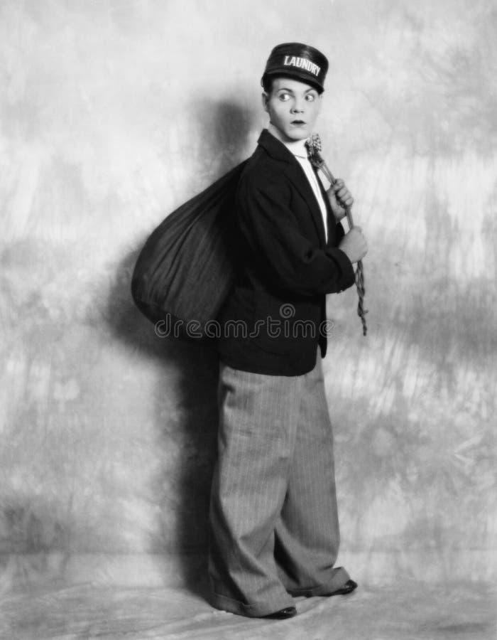 Mujer vestida como hombre del lavadero (todas las personas representadas no son vivas más largo y ningún estado existe Garantías  foto de archivo
