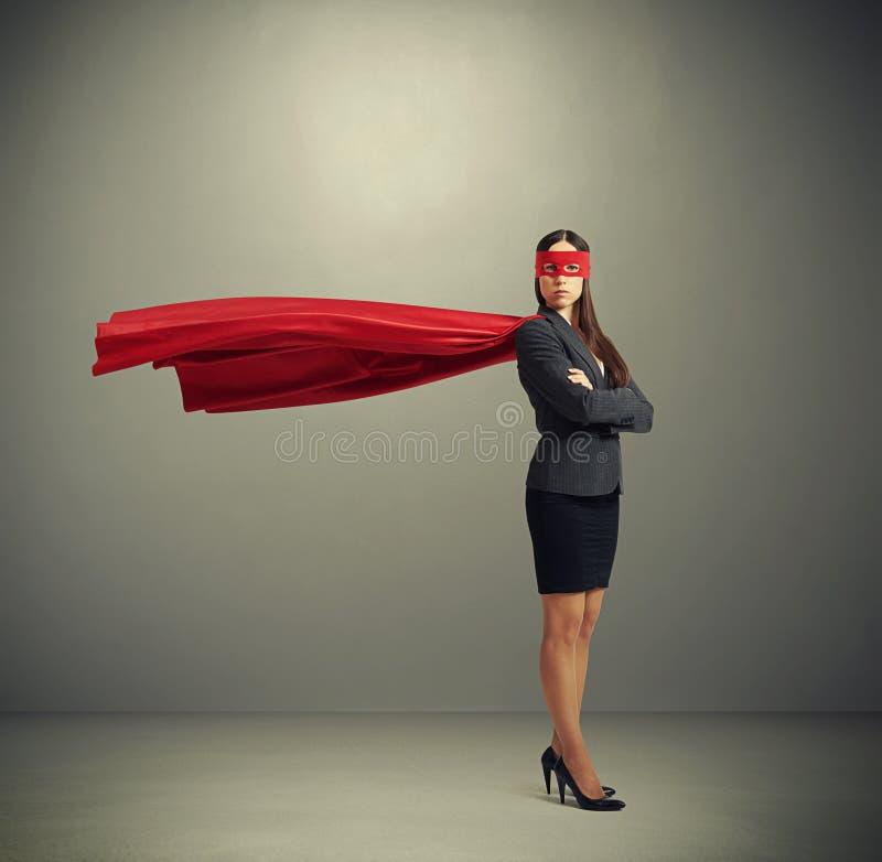 Mujer vestida como super héroe imagen de archivo