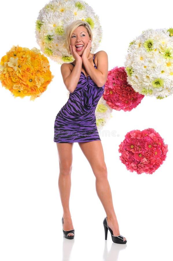 Mujer vestida en alineada púrpura fotografía de archivo
