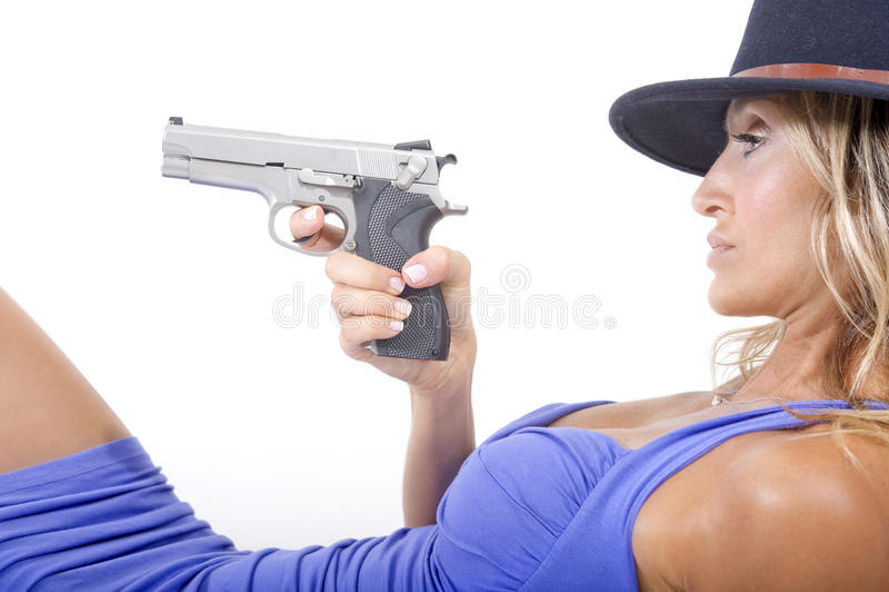 Mujer y arma fotografía de archivo libre de regalías