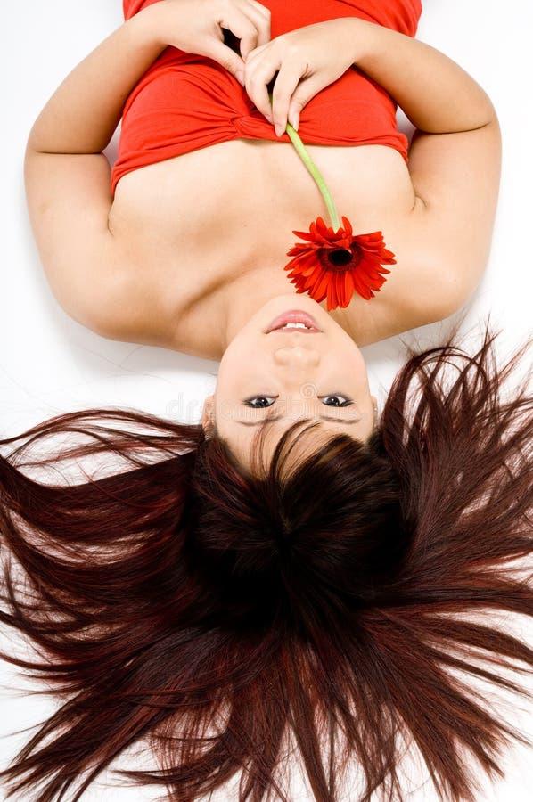 Mujer y flor imágenes de archivo libres de regalías