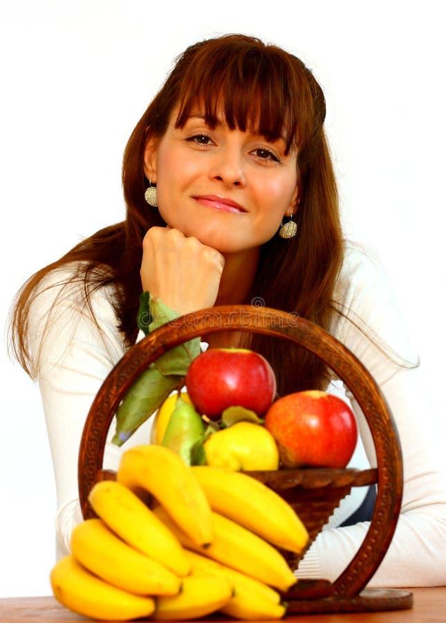 Mujer y frutas imagenes de archivo