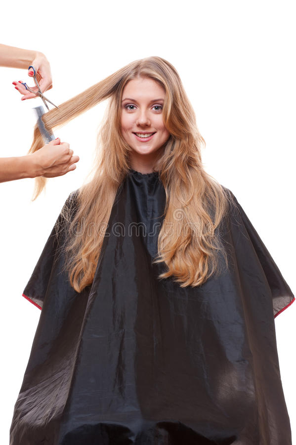Mujer y hairdreser sonrientes fotos de archivo libres de regalías