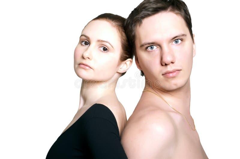 Mujer y hombre, presionados para arriba de nuevo a la parte posterior fotografía de archivo libre de regalías