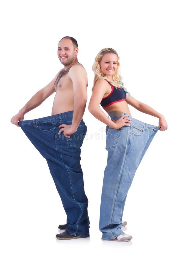 Mujer y hombre que sueltan el peso aislado en blanco fotos de archivo