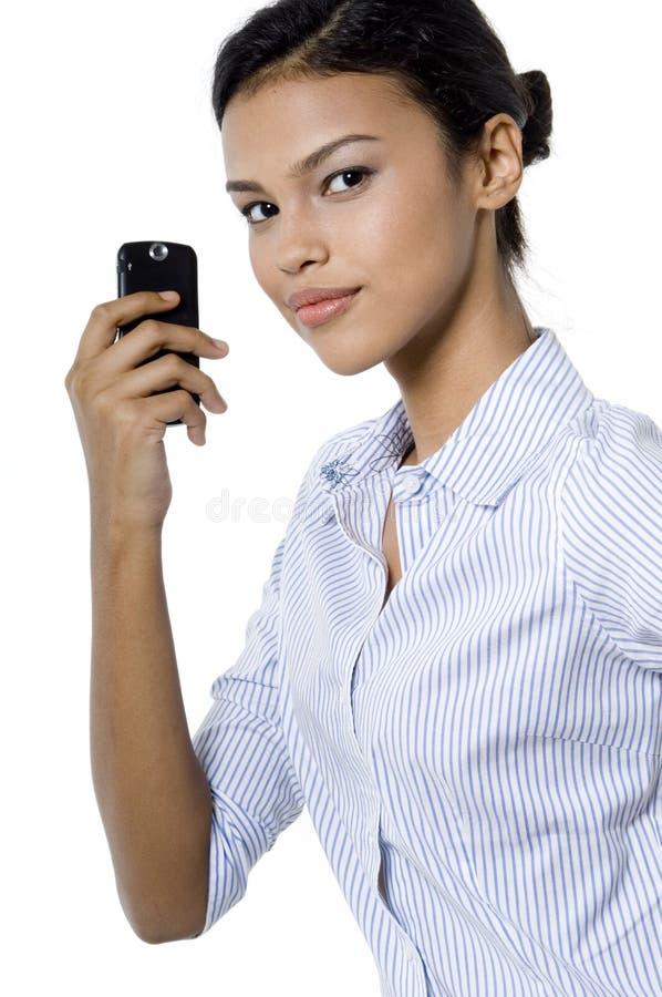 Mujer y teléfono imagen de archivo libre de regalías